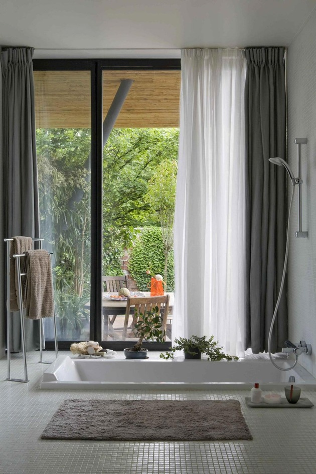 cantilevered-french-house-design-in-wood-and-glass-8.jpg