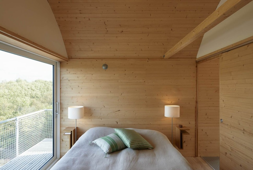 Corrugated metal beach houses with wood interiors for Wooden bed designs pictures interior design