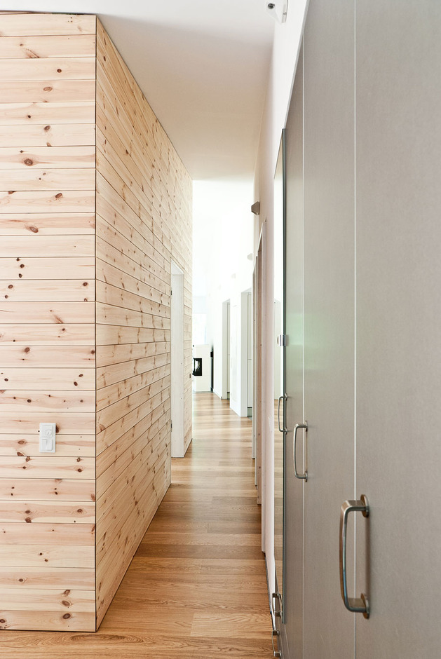 cozy-asymmetrical-home-with-wood-variety-14-hallway-doors.jpg