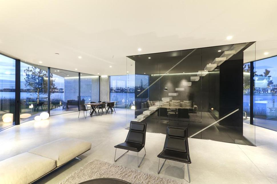 Diamond Shaped House With Curving Glass Windows