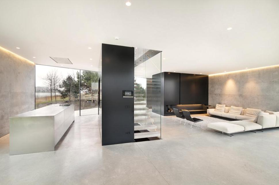 Diamond-Shaped House With Curving Glass Windows