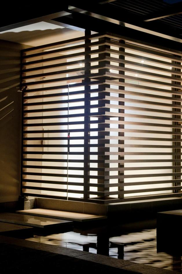 glass-steel-renovation-with-bedroom-bridge-10-wood-corner.jpg