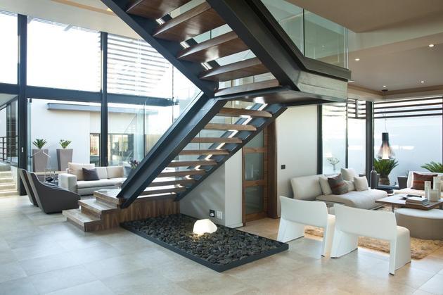 glass-steel-renovation-with-bedroom-bridge-14-living-space.jpg