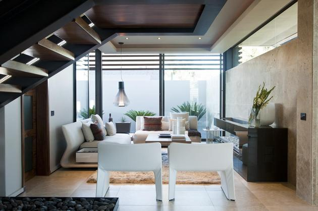 glass-steel-renovation-with-bedroom-bridge-18-under-stairs.jpg