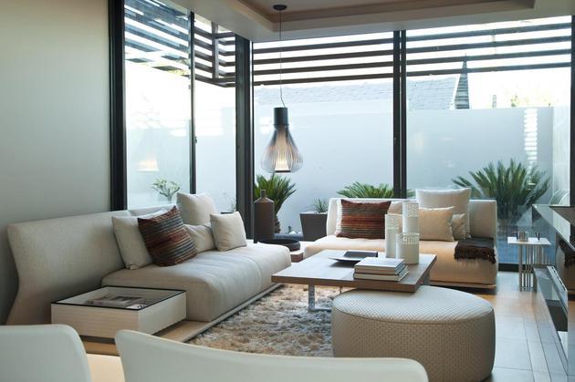 glass-steel-renovation-with-bedroom-bridge-19-living-area.jpg