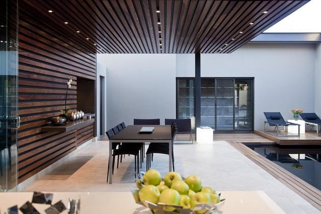 glass-steel-renovation-with-bedroom-bridge-7-outdoor-dining.jpg