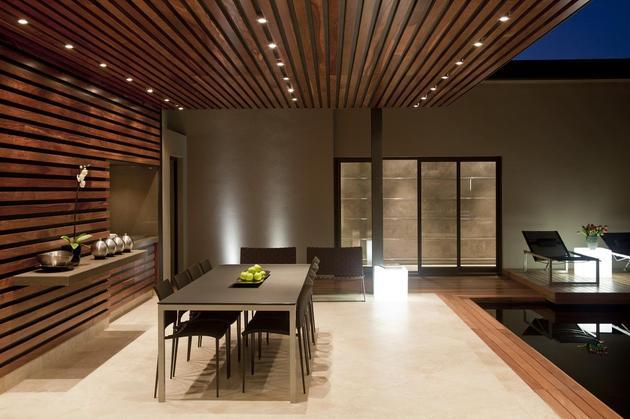 glass-steel-renovation-with-bedroom-bridge-8-outdoor-dining-night.jpg