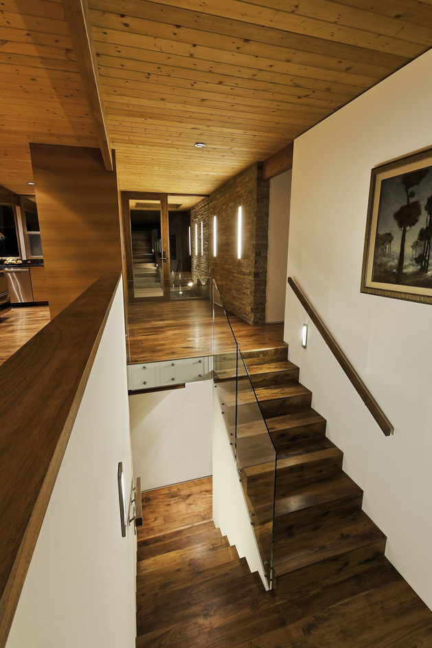 hillside-home-opened-up-post-beam-makeover-11-stairwell.jpg