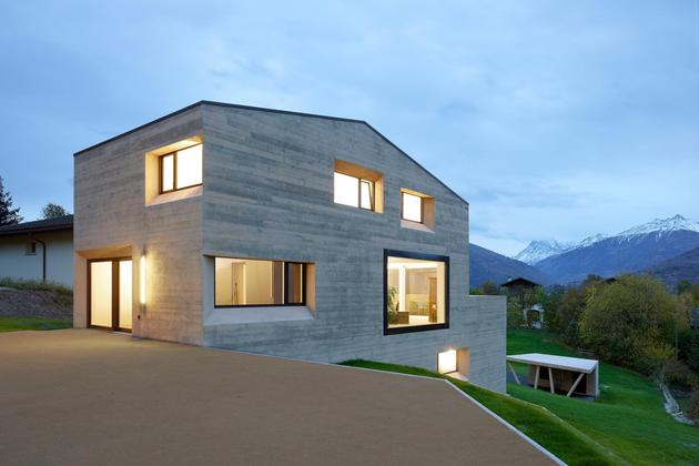 hillside house with wood look concrete covering 1 front right angle evening thumb 630xauto 39053 House With Wood Look Concrete Covering