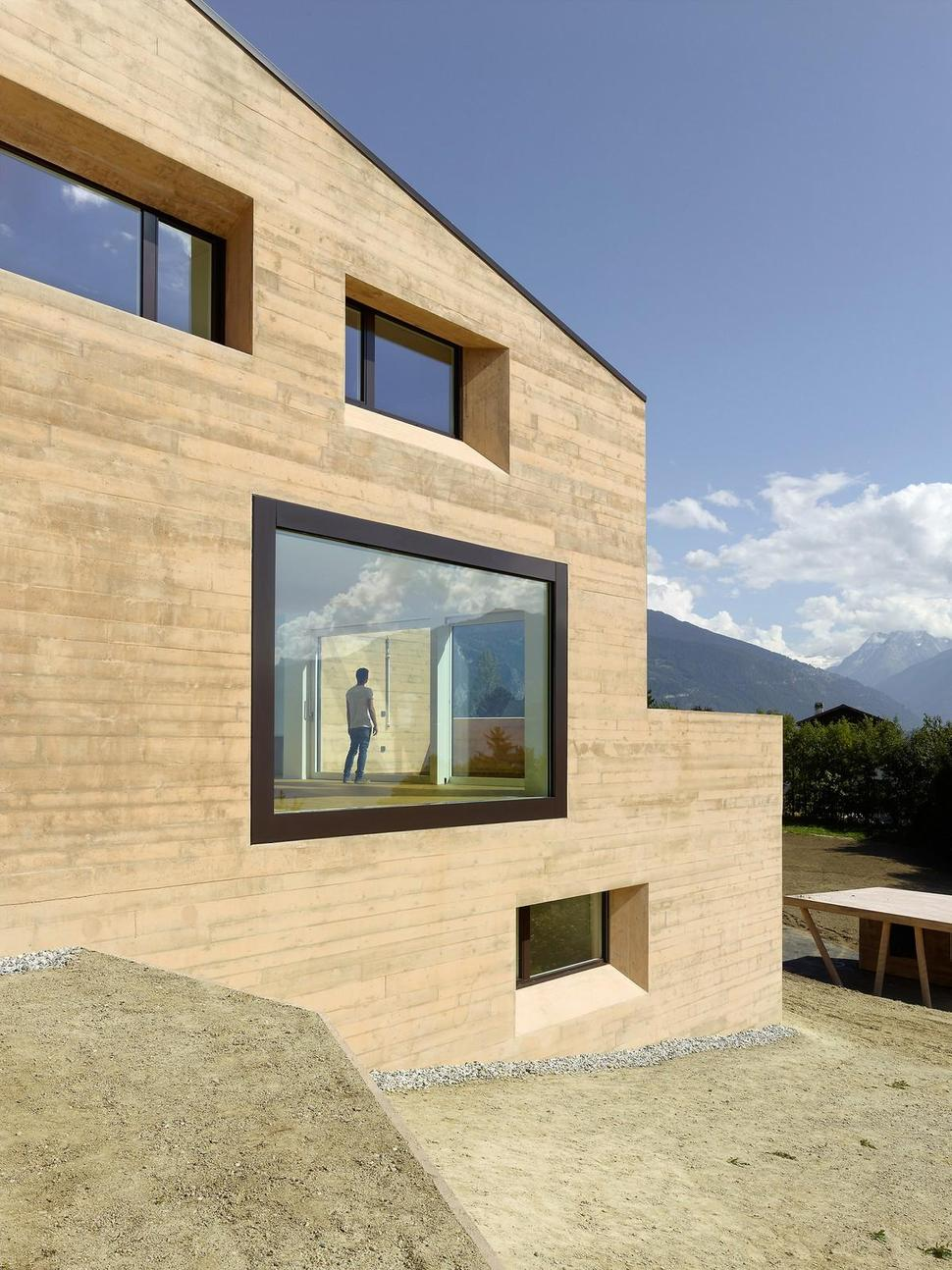House With Wood-Look Concrete Covering