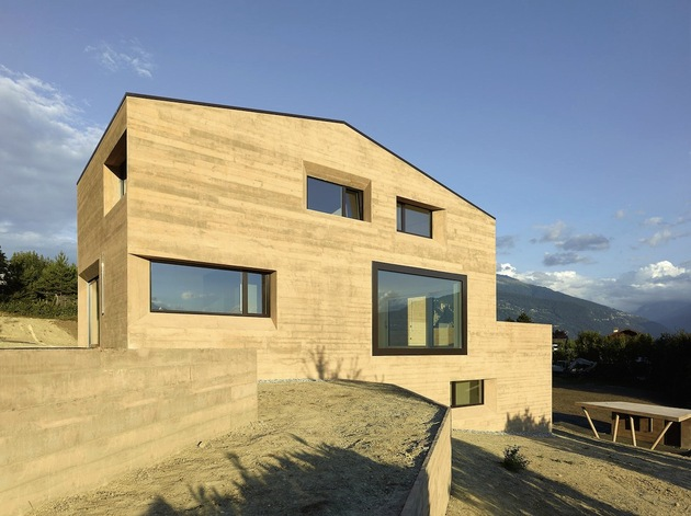 hillside-house-with-wood-look-concrete-covering-12-side-slight-angle.jpg