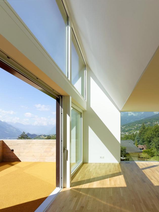 hillside-house-with-wood-look-concrete-covering-20-open-deck-door.jpg