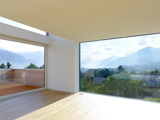 hillside-house-with-wood-look-concrete-covering-21-living-room-windows.jpg