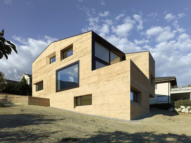 hillside-house-with-wood-look-concrete-covering-8-day-rear-left.jpg