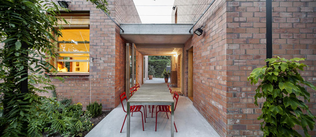 house-of-three-brick-boxes-and-outdoor-living-rooms-between-14.jpg