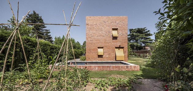 house-of-three-brick-boxes-and-outdoor-living-rooms-between-15.jpg