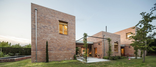 house-of-three-brick-boxes-and-outdoor-living-rooms-between-16.jpg
