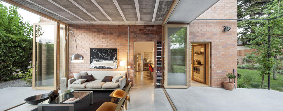 House of Three Brick Boxes and Outdoor Living Rooms Between
