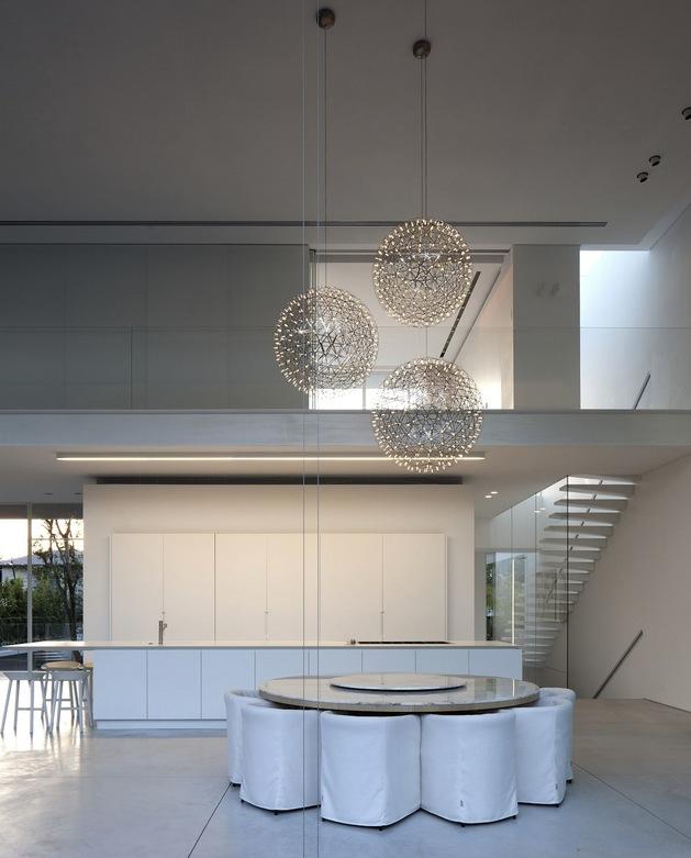minimal-house-with-hangar-style-rear-facade-21-dining-table-lights.jpg