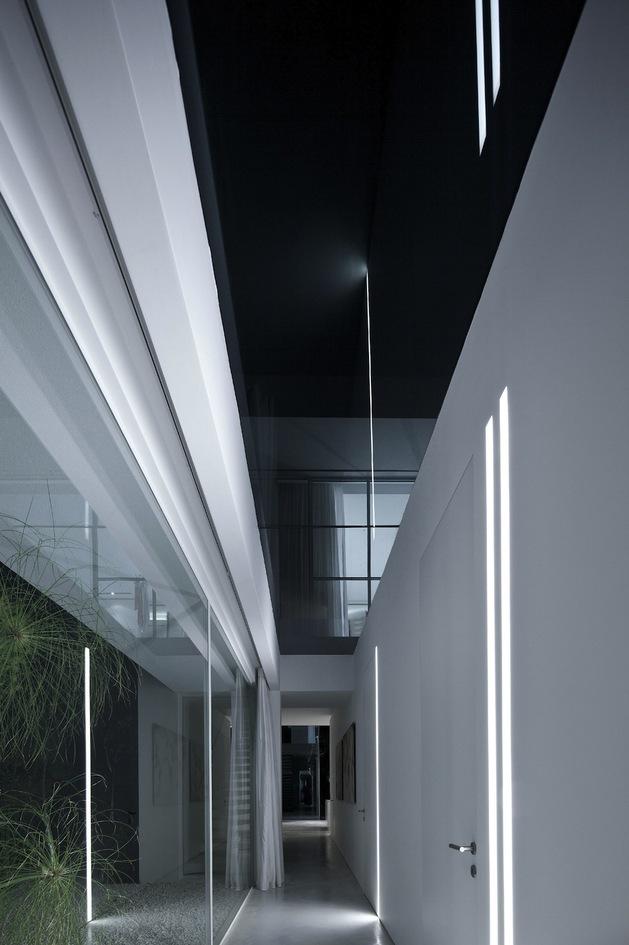 minimal-house-with-hangar-style-rear-facade-23-glass-hall.jpg