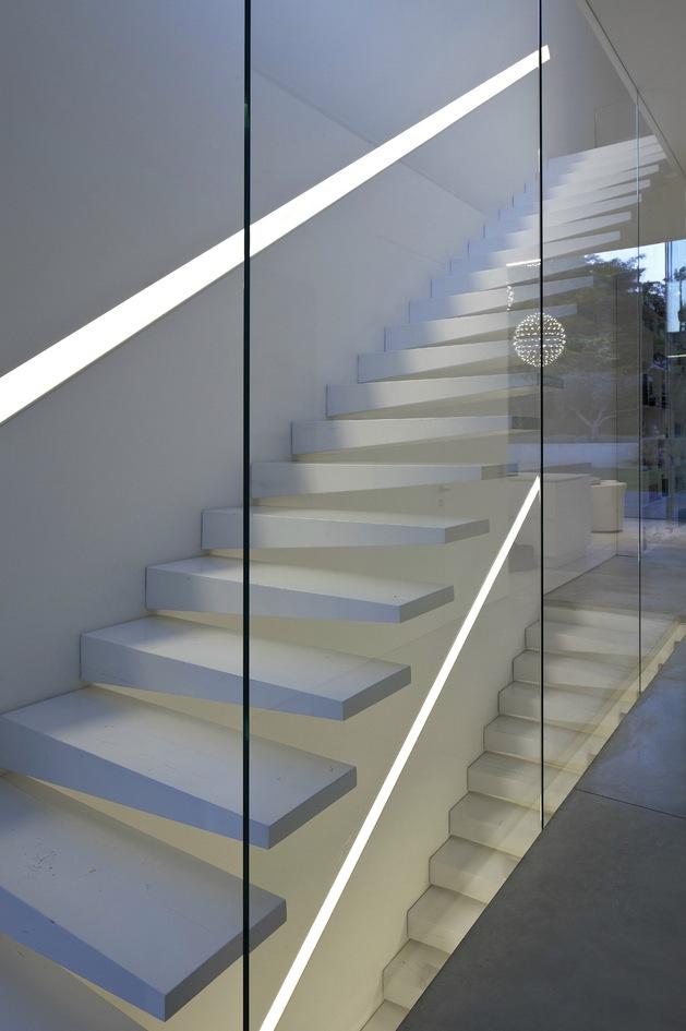 minimal-house-with-hangar-style-rear-facade-24-glass-stair-wall.jpg