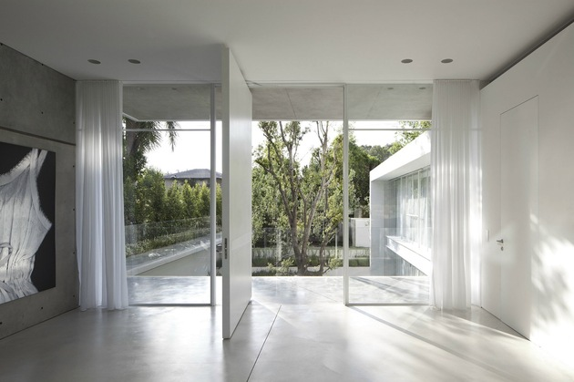 minimal-house-with-hangar-style-rear-facade-26-looking-out.jpg
