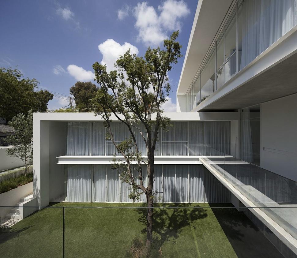 Minimal House With Hangar Style Rear Facade