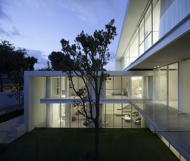 minimal-house-with-hangar-style-rear-facade-6-front-deck-evening.jpg