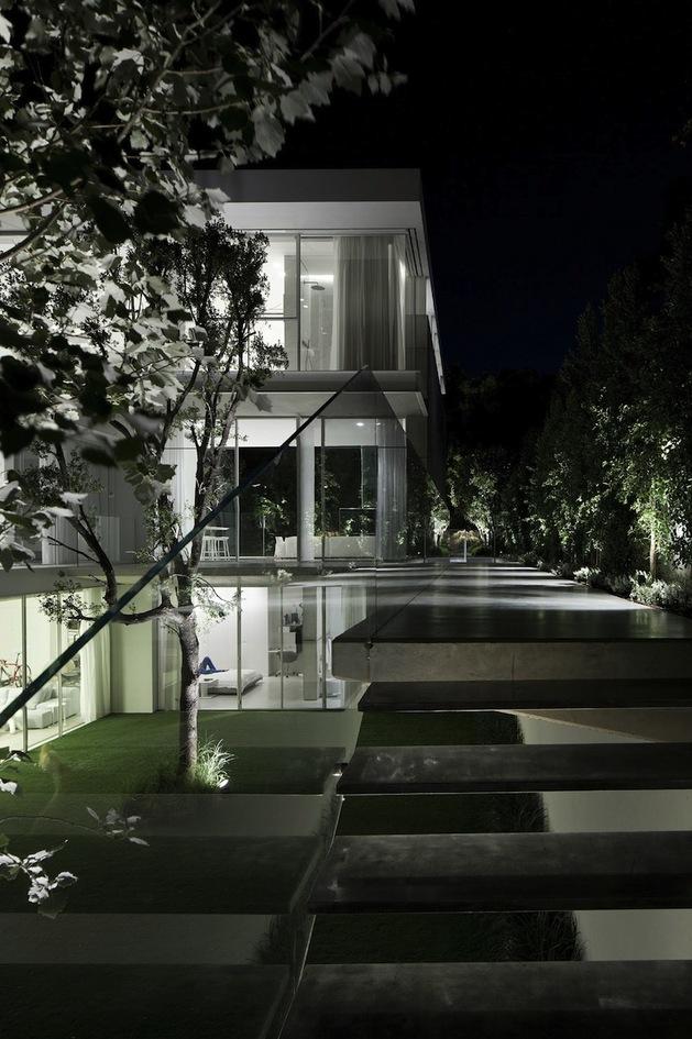minimal-house-with-hangar-style-rear-facade-7-outdoor-steps-night.jpg