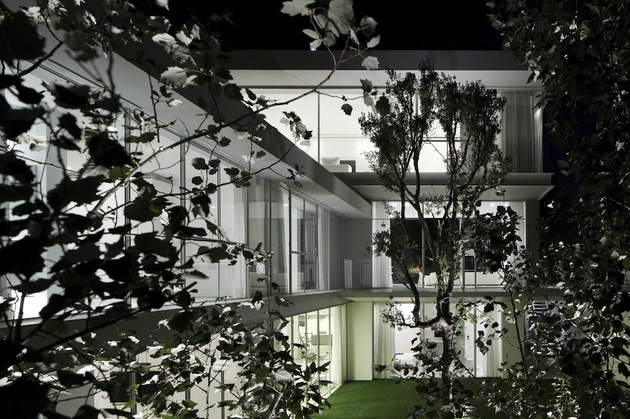 minimal-house-with-hangar-style-rear-facade-8-through-trees.jpg