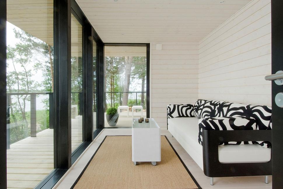 modern wooden vacation house built on rocks. Black Bedroom Furniture Sets. Home Design Ideas