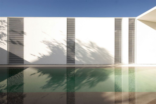 serene-white-house-with-walled-outdoor-space-4-pool-wall.jpg