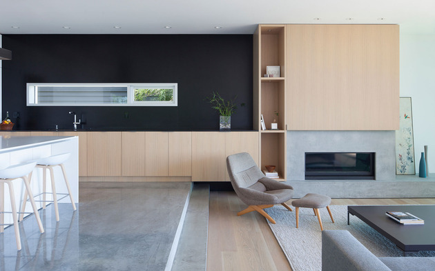 sleek-slope-house-with-interior-featuring-concrete-11-living-room.jpg