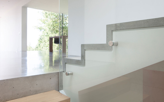 sleek-slope-house-with-interior-featuring-concrete-13-stairs-detail.jpg