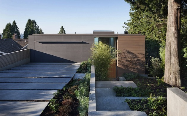 sleek slope house with interior featuring concrete 2 front thumb 630xauto 40069 Sleek Slope House With Interior Featuring Concrete