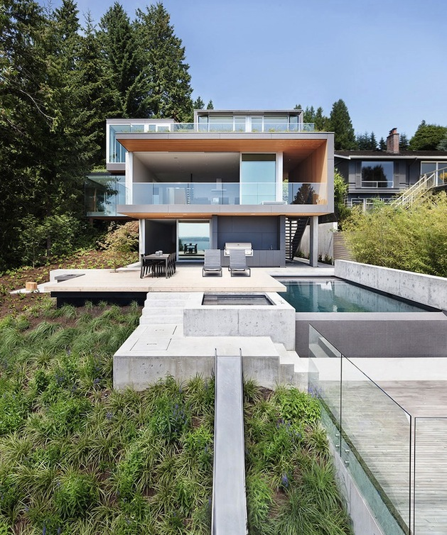 sleek-slope-house-with-interior-featuring-concrete-3-rear-straight.jpg
