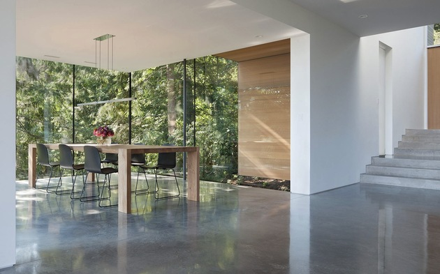 sleek-slope-house-with-interior-featuring-concrete-8-dining-room-angle.jpg