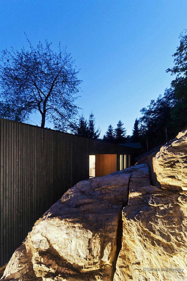 timber-cabin-built-into-cliff-side-site-18.jpg