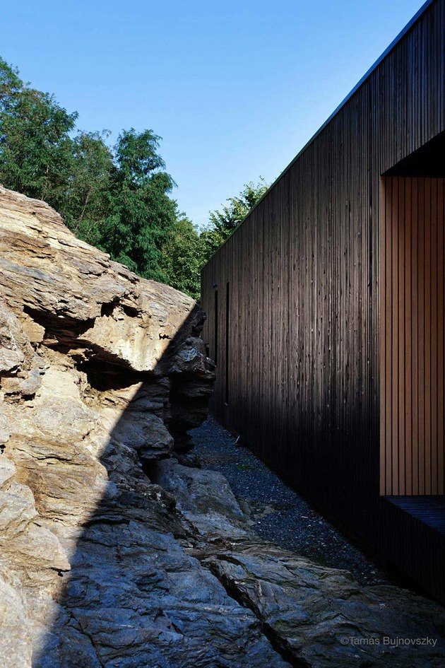 timber-cabin-built-into-cliff-side-site-7.jpg