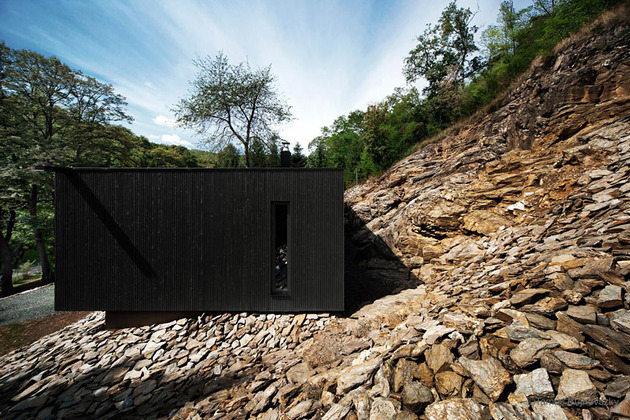 timber-cabin-built-into-cliff-side-site-8.jpg