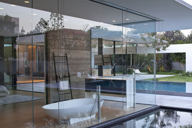 tranquil-glass-walled-house-with-innovative-furnishings-16-bathroom-window.jpg