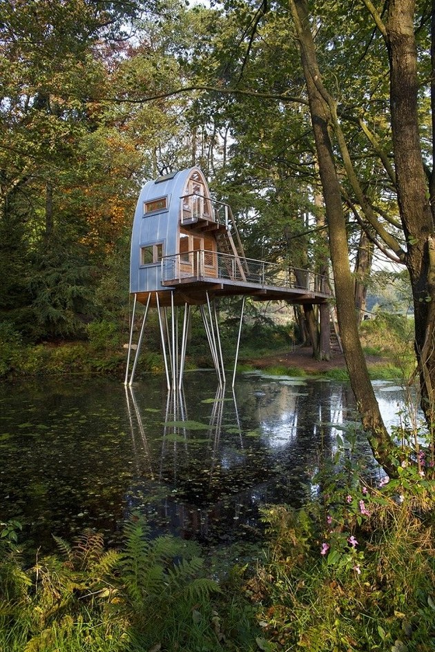 unusual forest cabin on stilts over pond 2 far angle thumb autox945 40426 Unusual Forest Cabin On Stilts Over Pond