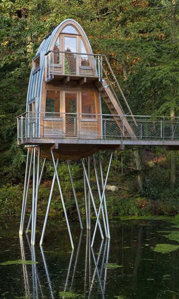 unusual-forest-cabin-on-stilts-over-pond-5-front-left.jpg