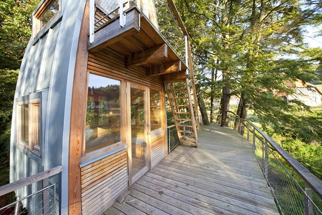 unusual-forest-cabin-on-stilts-over-pond-6-front-entrance.jpg