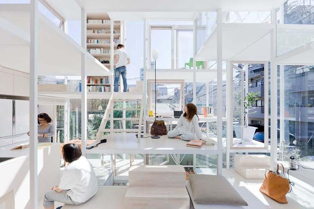 urban-glass-walled-house-with-platform-living-spaces-6-main-space.jpg