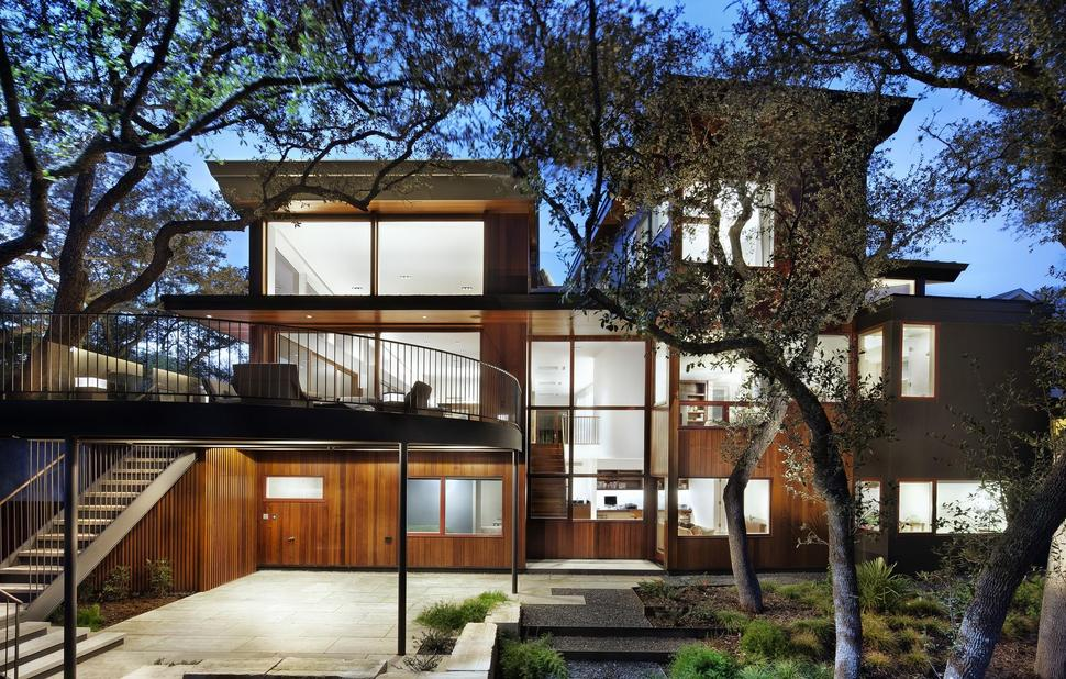 Wood and limestone house built among trees for Limestone homes designs