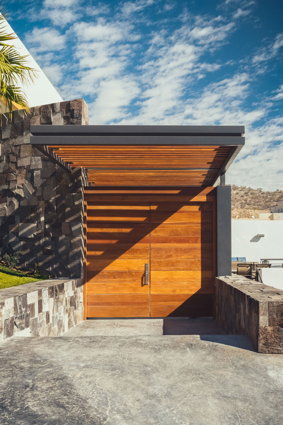 3 Level Slope House Has Deck Over Pool House