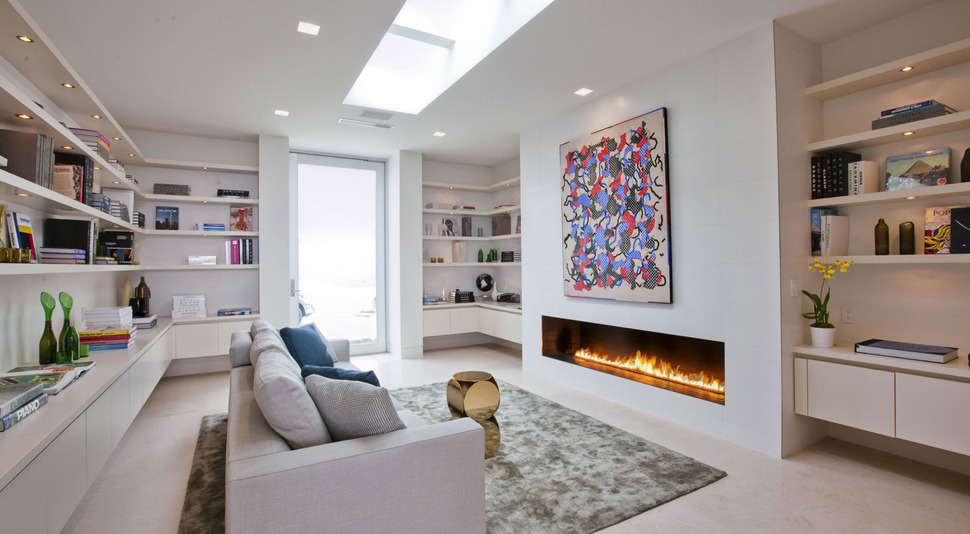 70s Home Transformed into Modern Beverly Hills Masterpiece Designs For Home Liry With Fire Place on
