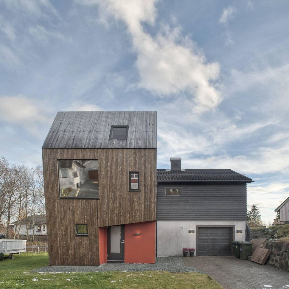 Angular home addition with plywood lined interior for Architectural design home additions