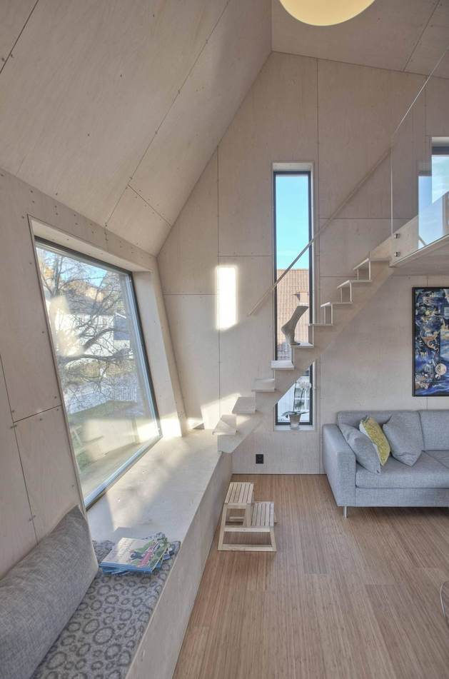 angular-home-addition-with-plywood-lined-interior-7-angled-walls.jpg
